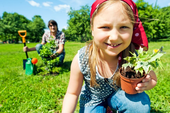 earth-day-activity-girl-planting-tree-700x465
